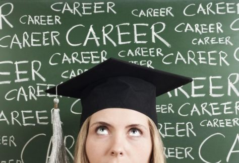 """Student with a blackboard behind them with the repeated words """"Career"""" written"""
