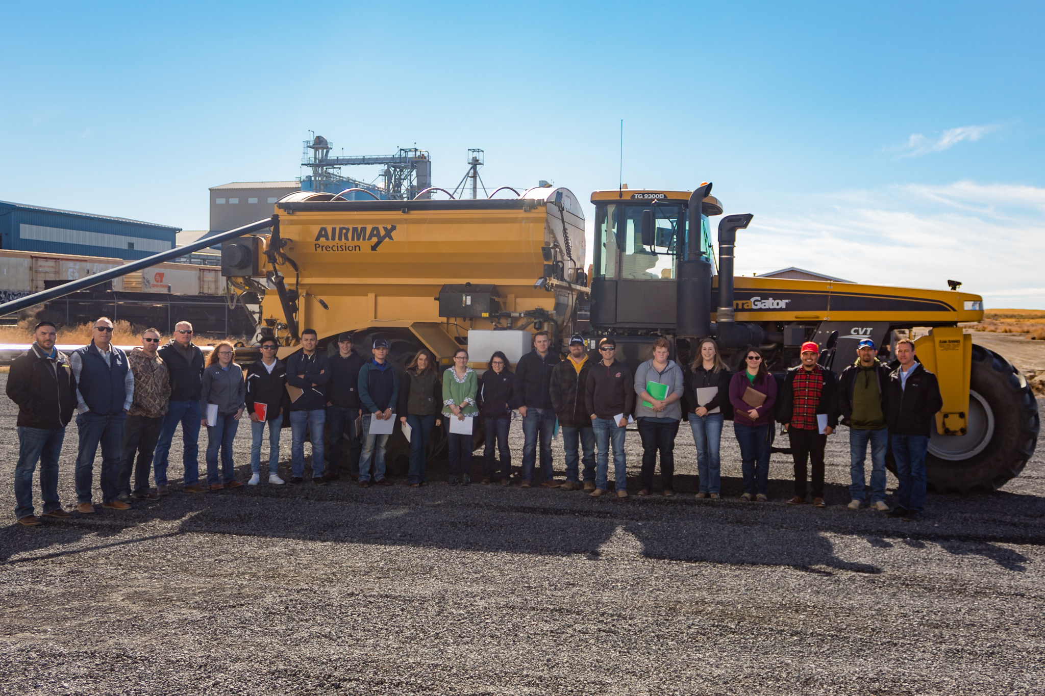 agriculture program students in front of a large farm truck