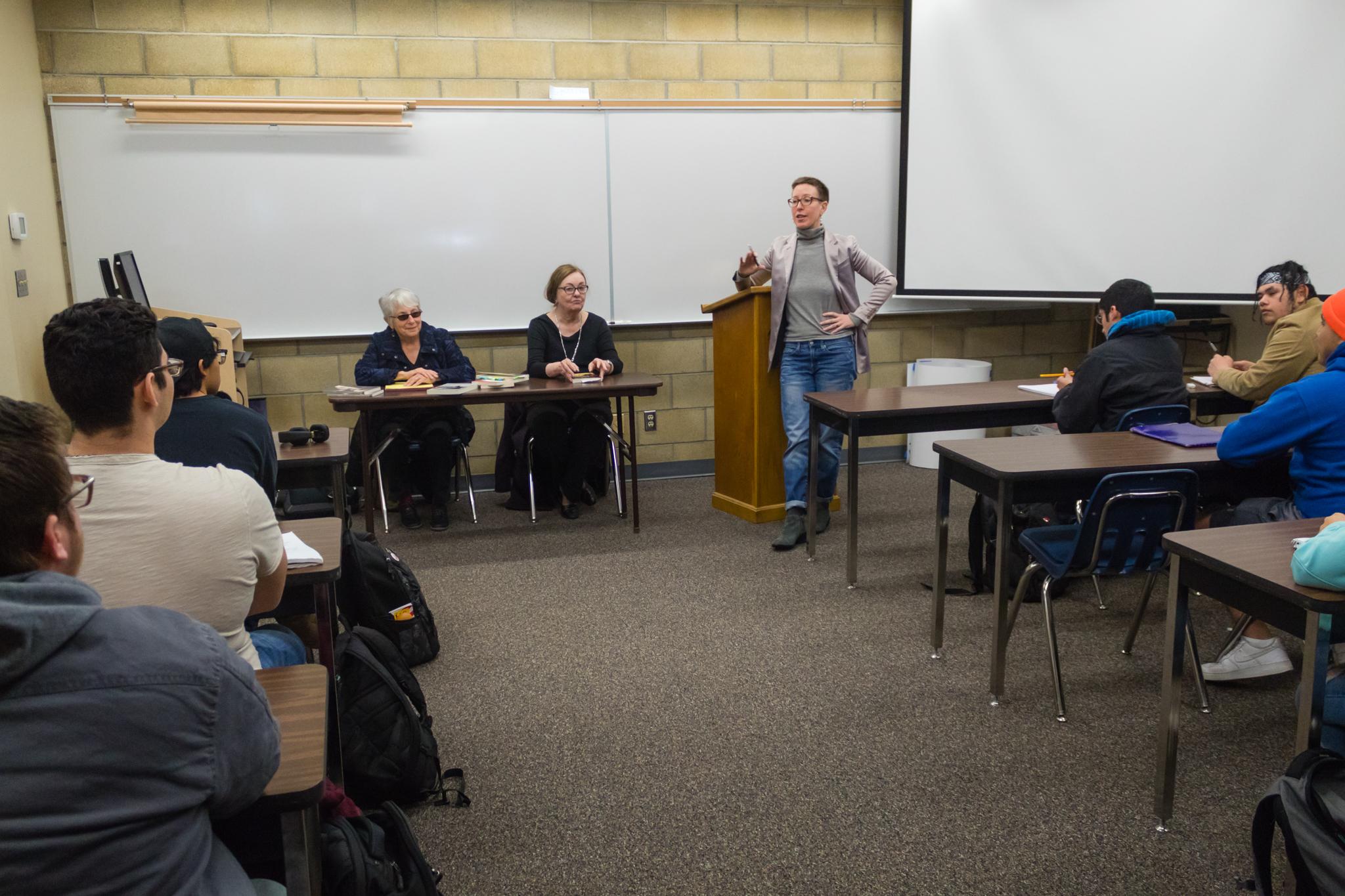 Allison Palumbo speaking to full classroom