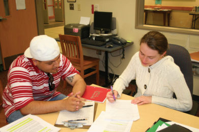 tutor with student in writing center